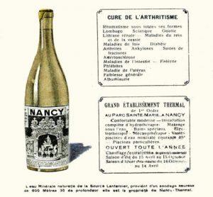publicité sur laquelle on voit une bouteille en verre avec une étiquette grilles Jean Lamour de la place Stanislas